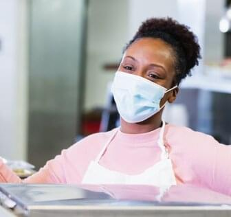 Woman wearing mask at work