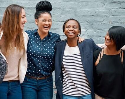 women gathered laughing