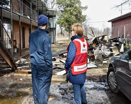 red cross worker providing aid