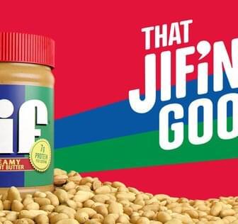 Stylized shot of peanut butter jar with marketing tagline
