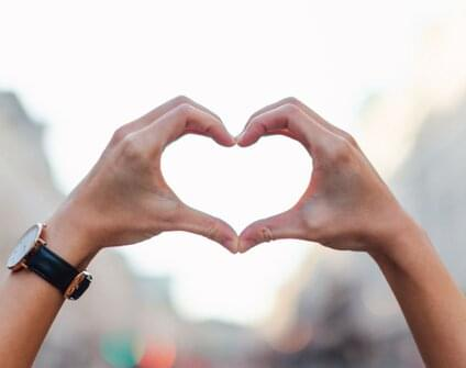 two hands together forming a heart