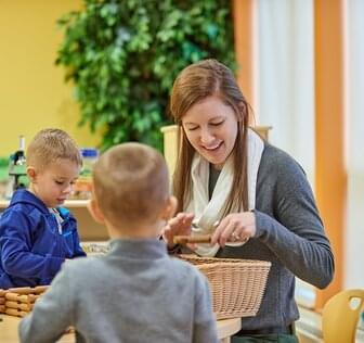 Teacher and children at Smucker Child Development Center