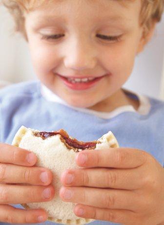 Boy eating Uncrustables