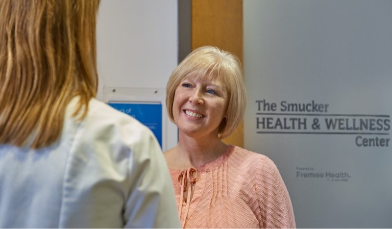 Woman smiling at Health and Wellness Center
