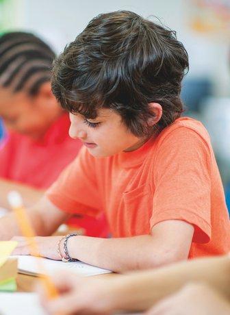 Child working on schoolwork