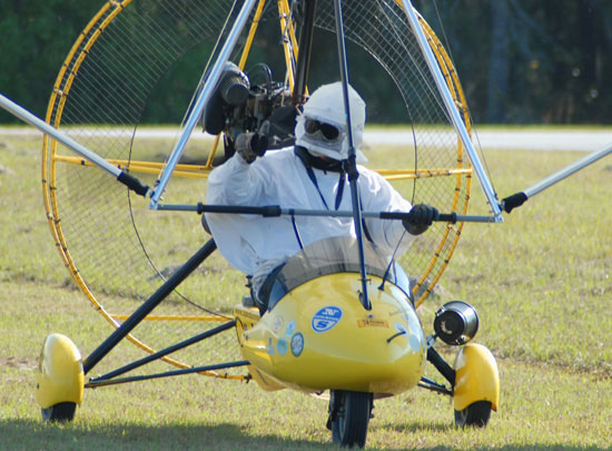 Ultralight planes with costumed pilot: they're  ready to fly.