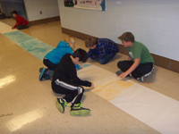 Students work on their poster