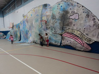 Students with life-size gray whale art they created