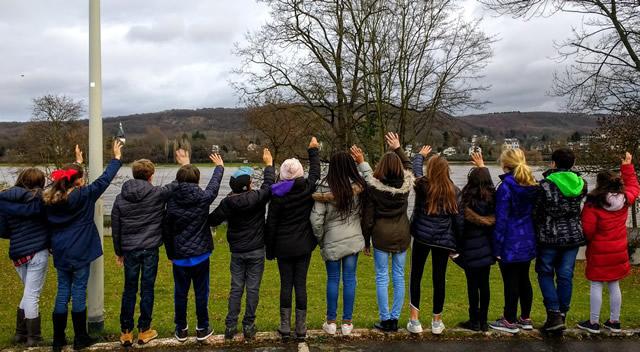 Students waving