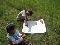 Children near monarch butterfly reserve in Mexico monitor arrival.
