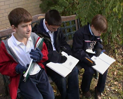 Students collect data for their school's database on robins.