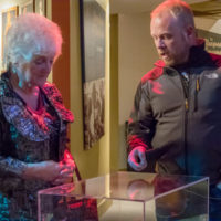 Jamie Dailey explains an item to Carolyn Vincent at the Dailey & Vincent exhibit at the International Bluegrass Music Museum in Owensboro, KY - photo by Ryan Hobson