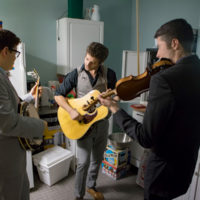 Jesse Baker, Shaun Richardson, and Patrick McAvinue warm up backstage before the concert at the grand opening of the Dailey & Vincent exhibit at the International Bluegrass Music Museum in Owensboro, KY - photo by Ryan Hobson