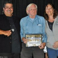 Bob Jeannin accepts her Dedication Award from Ernie and Debi Evans at the 2017 Yee Haw Music Festival - photo © Bill Warren