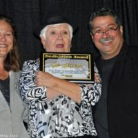 Jo Odom accepts her Dedication Award from Debi and Ernie Evans at the 2017 Yee Haw Music Festival - photo © Bill Warren