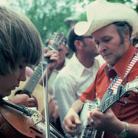 A young Tim Crouch jamming with his uncle Dub at Mountain View, AR.
