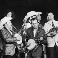 PBS taping circa 1972. Dub Crouch and Herman Beck on banjos. Don Brown, Stan Waggoner, and Norman Ford visible in background. The event called in John Hartford, Dub Crouch - Norman Ford and The Bluegrass Rounders, And Don Brown and The Ozark Mountain Trio.