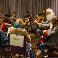 Cliff helps lead his band at the Youth Academy at Wintergrass 2017 - photo © Tara Linhardt