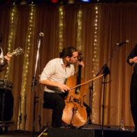 Jeremy Kittel Band (Joshua Pinkham (mandolin), Nathaniel (cello), Jeremy Kittel (fiddle) at Wintergrass 2017 - photo © Tara Linhardt