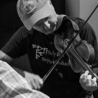 Pete Martin jammin in the hallways at Wintergrass 2017 - photo © Tara Linhardt