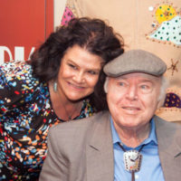 Roy Clark poses with interviewer Pam Tucker at the American Banjo Museum