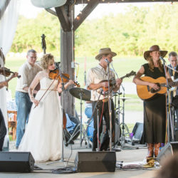 Laura Orshaw and Tony Watt sit in with the Caleb Klauder Country Band following their wedding ceremony (June 10, 2017) - photo by Adam Frehm