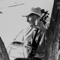 Banjo picker in Stickerville campground at Weiser 2017 - photo © Tara Linhardt