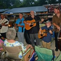 Harbourtown plays without amplification after a thunderstorm sht down the sound system at the 2017 Charlotte Bluegrass Festival - photo © Bill Warren