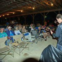 The music continues without amplification after a thunderstorm sht down the sound system at the 2017 Charlotte Bluegrass Festival - photo © Bill Warren