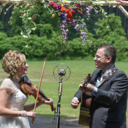 Laura Orshaw and Tony Watt sing Magnolia Wind to each other during their wedding ceremony (June 10, 2017) - photo by Adam Frehm