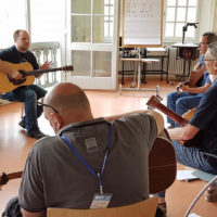 Rick Faris leads the guitar class at Bluegrass Camp Germany 2017