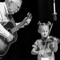 The youngest fiddler, Sorella High, age 5 from Blackfoot, ID at Weiser 2017 - photo © Tara Linhardt