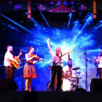 The Mountain Music Ambassadors perform in China: Andrew Preston, Sarah Wood, Raymond McLain, Matt Holleran, Austin Tackett, Melissa Caskey