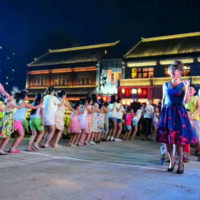 Chiese students dance to the Mountain Music Ambassadors