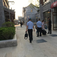 Chinese security guards assist the Mountain Music Ambassadors getting their instruments to the stage