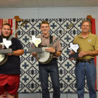 Brady Gandy, Hudsen Docuette, and Eric Welty, top finishers in the Texas Banjo Championship for 2017 with their trophies - photo by Tina Boatwright