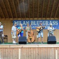 Mark Gaynier hosts an open stage jam session at the 2017 Milan Bluegrass Festival - photo © Bill Warren