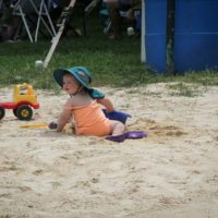 Digging in the sand at the August 2017 Gettysburg Bluegras Festival - photo by Frank Baker