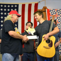 Texas Guitar Champion for 2017 Adam Greer accepts his trophy from Rick Kirkland, BABA Prseident - photo by Tina Boatwright