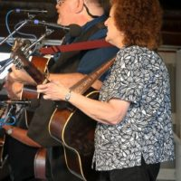 Eddie Gill and Teresa Sells with Big Country Bluegrass at the 2017 Delaware Valley Bluegrass Festival - photo by Frank Baker