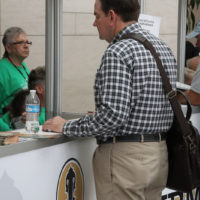 Joe Mullins at the registration desk for the IBMA World Of Bluegrass in Raleigh - photo by Frank Baker