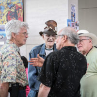 Tom Gray, Carl Padger, and Bill Knwolton chat during the2017 IBMA World Of Bluegrass in Raleigh - photo by Frank Baker