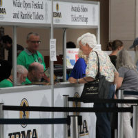 Tom Gray registers at the 2017 IBMA World Of Bluegrass in Raleigh - photo by Frank Baker