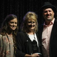 Carolina In The Fall accepts their Momentum Award during World of Bluegrass - photo by Frank Baker