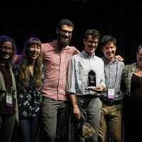 Mile Twelve accepts their Band Momentum award from Molly Tuttle during World of Bluegrass - photo by Frank Baker