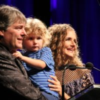 Hosts Béla Fleck and Abigail Washburn with their son, Juno, at the 2017 IBMA Awards - photo by Frank Baker