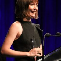 Molly Tuttle accepts her Guitar Player of the Year award at the 2017 IBMA Awards - photo by Frank Baker