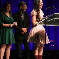 Sierra Hull accepts her Mandolin Player of the Year award at the 2017 IBMA Awards - photo by Frank Baker