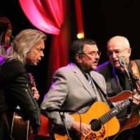 Tim Surrett, Jim Lauderdale, Larry Cordle, and Carl Jackson at the 2017 IBMA Awards - photo by Frank Baker