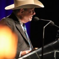 Bobby Hicks accepts his induction into the Hall Of Fame at the 2017 IBMA Awards - photo by Frank Baker